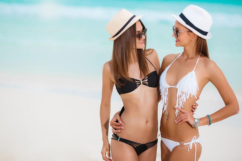 Two sensual women in bikini on a beach