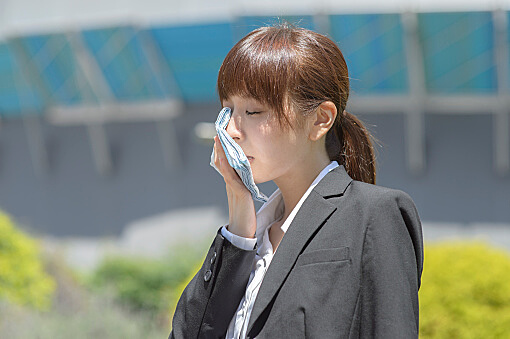 Young woman wiping the sweat